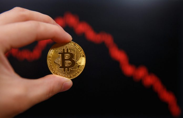Expert: Bitcoin Might Strike $9,000 Must Bearish Breakdown Occur; Here's Why